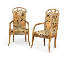 'CLEMETIS' A PAIR OF LOUIS MAJORELLE CARVED MAHOGANY AND PARCEL GILT ARMCHAIRS -  CIRCA 1910