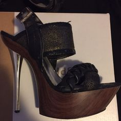 0b6c7b4ab163 Shop Women s bebe Black Gold size 8 Platforms at a discounted price at  Poshmark. Description  Black high heels with gold accents.