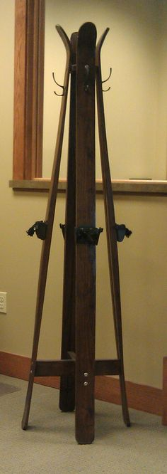 Great idea for rustic coat hanger at a ski cabin. Made of old skis, I love it.