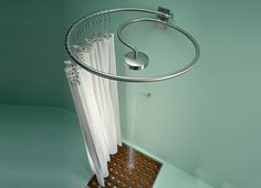 Spiral shower curtain rod... so neat