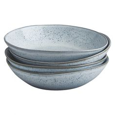 A Habitat-exclusive design, the beautiful Olmo light blue speckled pasta bowl has a natural, organic shape with a rim in a complementary earth tone.[br]Made in Portugal, the durable stoneware bowl is part of the Olmo range of tableware and, due to the reactive glaze, no two pieces are alike.[br]Set includes 4 pasta bowls.[br]Other colours available in the range.