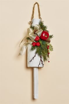 "19"""" White Buoy with Holiday Greens, Red Apples, a Red Pomegranate and Berries with a Platinum Bow"