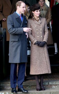 DECEMBER 25, 2014 The Duchess of Cambridge attended Christmas Day Service at St. Mary Magdalene Church at Sandringham Estate in Norfolk, England, with Prince William and donned a tweed calf-length coat, dark tights, and a hat and pumps in matching brown.