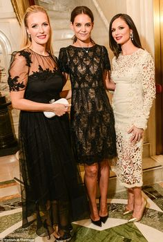 Elegant: Katie caught up with her dress's designers Keren Craig and Georgina Chapman at the party