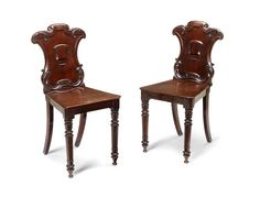 A pair of mid Victorian mahogany hall chairs (2)