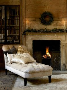 Love the chaise lounge by the fireplace.