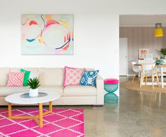 A beautiful riot of bright hues and playful patterns takes command in this busy Hamilton home