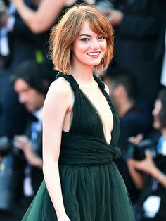A glam Emma Stone strikes a pose at the Venice Film Festival in Italy, where she promoted her new film Birdman on Wednesday night.
