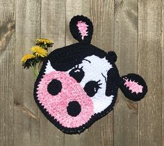 Thank you for visiting my shop! This cow pot holder is simple enough for the beginner crocheter in you! You will need to know how to start with a magic circle, single crochet, half double crochet, double crochet and treble crochet. The pattern lists simple colors that were used, but