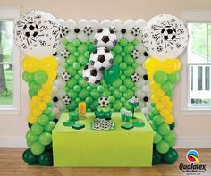 Are you ready to #party for the World Cup? Here is some inspiration for your decor: column topped with 3 ft balloons, a wall with 9'' Microfoil soccer ball balloon accents and a bouquet for the dessert table. #qualatex #balloon #worldcup #soccer: