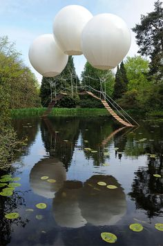 """Pont de Singe"" by French artist Olivier Grossetête is a bridge that is suspended by three large helium-filled balloons. The ultralight bridge is not functional but rather was a sculptural installation from the 2012 Tatton Park Biennial in the UK."