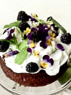 Chocolate cake, topped with Greek Yogurt, blackberries, pansies & mint leaves.
