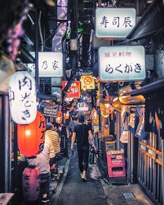 """@tomjauncey taking you through the hidden alleys of #Tokyo . """"This is the amazing Golden Gai in Shinjuku. It's an iconic colourful alleyway that is filled with culture and a must visit for photographers . Golden Gai has a very authentic #Japanese feel to it bustling with little bars, restaurants, cherry blossoms and signs. It's a tight squeeze as you can only fit 4 or 5 people in each venue. Perfect for a local meal and drink."""" : @tomjauncey"""