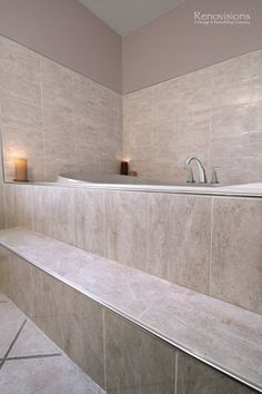 Bathroom remodel by Renovisions. Contemporary style, jacuzzi tub, tiled steps, metal trim, chrome fixtures, tiled shower surround