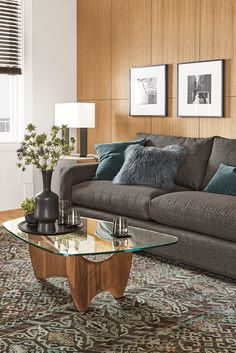 Sanders is a mid-century-inspired coffee table with a solid wood base and tempered glass top. Room Furniture, Modern Coffee Tables, Chair And Ottoman, New Furniture, Ottoman In Living Room, Furniture, Table, Custom Table, Coffee Table