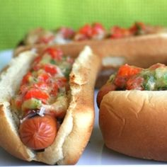 Hot Dogs with Manchego Cheese, Roasted Garlic and Roasted Red Pepper Relish - slightly more sophisticated than your average dog.