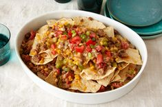 10 Nachos Recipes — If you think nachos are just for fiestas, think again! Our nachos recipes also include quick and easy dinners, too—with quick skillet dishes, cheesy nacho casseroles and nacho entrée salads. Baked Nachos, Cheesy Nachos, Mexican Dishes, Mexican Food Recipes, Ethnic Recipes, Mexican Cheese, Nacho Cheese, Appetizer Recipes, Snack Recipes