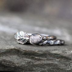 Raw and nature inspired...this twig style ring accented with a leaf features a natural raw uncut rough diamond bezel set in sterling silver on a sterling silver band inspired by a tree branch. The raw diamond measures approximately 4.5 - 5 mm in size and weighs approximately 1/2 carat. The width of the band is approximately 2 mm and does vary due to the knots and bends in the twig styling. This wedding set has been oxidized to create a dark patina accenting the texture and pattern.  THIS...