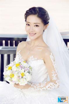 Chinese actress Deng Jiajia http://www.chinaentertainmentnews.com/2015/06/gorgeous-deng-jiajia-in-wedding-gown.html