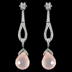 Rose Quartz and Diamond Earrings. These earrings have a total of 30.97 carats of Rose Quartz and 1.51 carats of Diamonds.