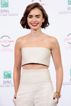 Actress Lily Collins attends 'Love, Rosie' Photocall during the 9th Rome Film Festival at Auditorium Parco Della Musica on October 19, 2014 in Rome, Italy.