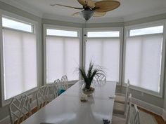 ASAP Blinds | Honeycomb shades in a dining room.