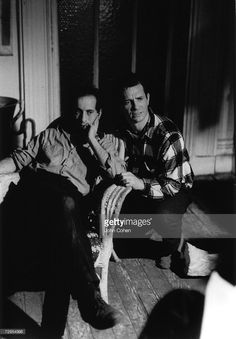 Swiss-born American photographer and film director Robert Frank (left) sits with head on hand and American Beat poet Jack Kerouac (1922 - 1969) kneels next to him as they look on at the action of the set of the film 'Pull My Daisy,' directed by Frank, written by Kerouac, and starring their friends, Greenwich Village, new York, 1959.