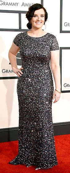 The Grammy nominee shimmered in an embellished midnight column with short sleeves.