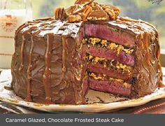 Here we have a steak cake. The steak looks rare and has some nasty filling oozing out between the layers. Then to top off this horrific dish they covered it with chocolate frosting and some kind of caramel looking drizzle. If you can stand to see any more please check out my SOME INEDIBLE STUFF board .I hope you enjoy this board. Go forth and pin freely! ;-)