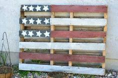 Redo a pallet flag for the front yard in front of the right side of the house up against the fence.