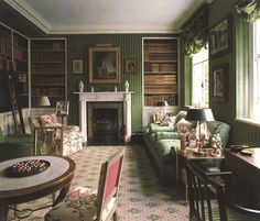 Colefax & Fowler ~ library's covered walls, in a green velour de lin, works so well with the Buxted carpet, damask upholstery and hints of floral.
