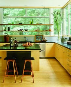 I love the lines of this kitchen and the views outside this window. Peaceful cooking.