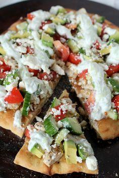 fresh homemade greek pizza with greek yogurt, garlic, chicken, cucumber, avocado and feta cheese. nommmm