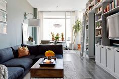 The first order of business was to rid the apartment of its cold white floors and refinish the space with rich, warm, natural wood flooring.Related: A Lesson In Beautiful Bathrooms #refinery29 http://www.refinery29.com/homepolish-village-blues#slide-3