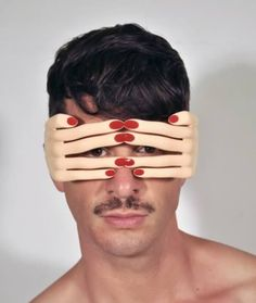 Peek-A-Boo Hands Glasses : Rivaling the tacky factor of The USA Sunglasses is the Jeremy Scott Flesh Hands frame by Georgio.