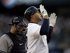 Detroit Tigers' Jhonny Peralta reacts after hitting a two run home run in the fourth inning as New York Yankees catcher Russell Martin looks on during Game 4 of the American League championship series Thursday, Oct. 18, 2012, in Detroit. (AP Photo/Matt Slocum)