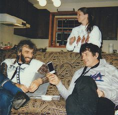 Richard Manuel with Rick Danko and his wife Elizabeth Danko, looking over pictures