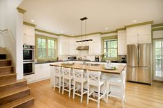 love the crown molding painted with accent color :-) Contemporary Crown Molding Kitchen