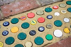 beer bottle top path stones...think I will try this one using concrete.