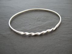 Sterling silver bangle with a tight twist by AnnaAncellJewellery