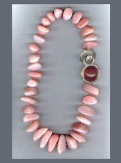 N-2527 Peruvian pink Opal tumbled beads on a pink Quartz Cabochon and Diamond Ridged clasp, 18K white Gold