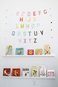 Alphabet art over book display in White and Bright Nursery