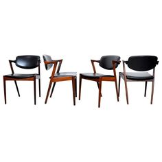 Set of Four Kai Kristiansen Model 42 Rosewood Dining Chairs | From a unique collection of antique and modern dining room chairs at https://www.1stdibs.com/furniture/seating/dining-room-chairs/
