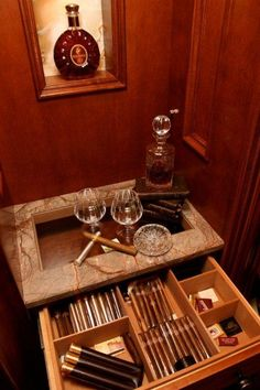 Closet with built-in cigar humidor  |  Read more at ClosetsDaily.com  I wanna have this!!!