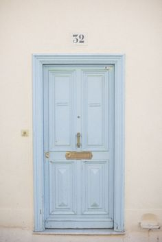A pale blue door in Nice, France.