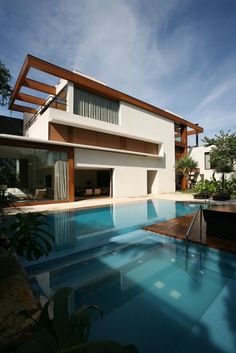 What do you think of this home?  Brazilian Architect Arthur Casas has designed the 'Jardim Paulista' residence located in São Paulo, Brazil.  Arthur Casas is one of the most awarded Architects and Interior Designers in Brazil and Internationally!