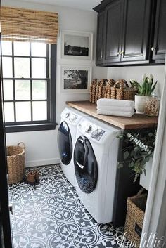 Add Interest With Contrast - 10 Laundry Room Ideas We're Obsessed With - Southernliving. Clean white walls paired with rich black cabinetry sets up the perfect scheme for the intricate tile. Bamboo shades are a cost-efficient buy and keep the walls streamlined, while framed (black-and-white!) photos make it personal.  See Pin