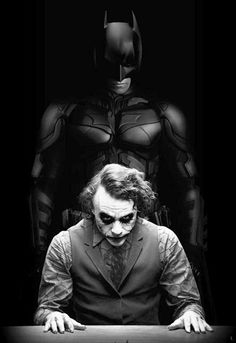 "Heath as the Joker and Christain as Batman in ""The Dark Knight"""