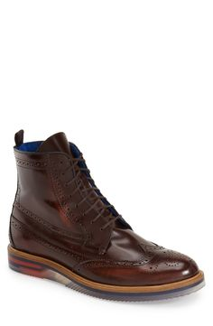 Ted Baker London 'Garthh' Wingtip Boot (Men) | Fashiondoxy.com DEscription - Free shipping and returns on Ted Baker London 'Garthh' Wingtip Boot (Men) at Fashiondoxy.com. Timeless wingtip panels mark a glossy leather boot crafted in Portugal for a sharp, masculine silhouette with a unique, translucent rubber sole