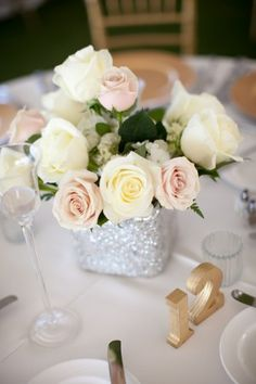 Rose Wedding Centerpiece... And I like the color scheme